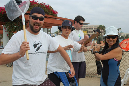 Coastal Cleanup Day volunteers ready to jump into kayaks and clean the marina of trash. Join us on Sept. 20!